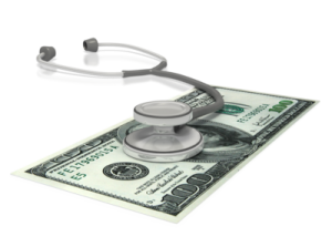 Doctor's stethoscope on top of US dollars