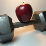 apple balanced on top of barbell