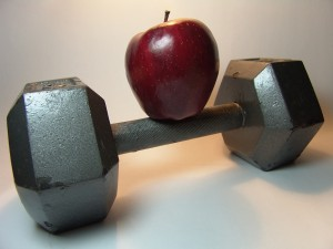 apple atop a dumbbell