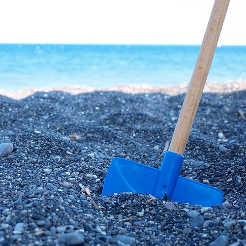 health insurance crisis in America represented by a spade in the ground