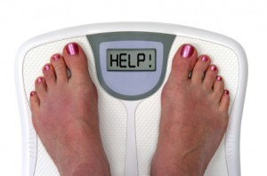 feet on bathroom scale showing the word HELP